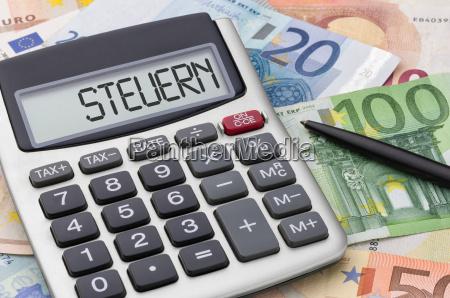 calculator with money bills taxes
