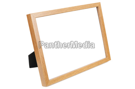 wooden empty photo frame on white