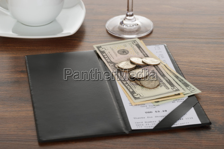 bill with american dollars on table