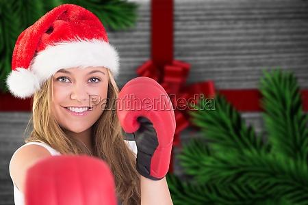 imagen compuesta de perforacion rubia festiva