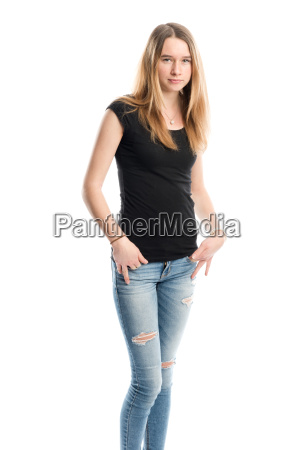 young girl in jeans looking serious