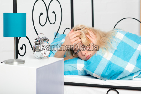 young woman in bed has no