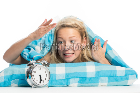 young woman lying in bed and