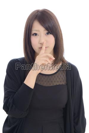 dedo labios mujer de negocios secreto