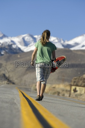 young woman skateboarding in bishop ca