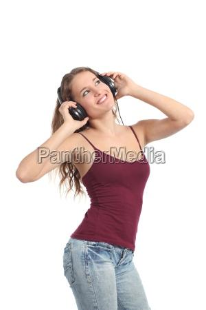 chica guapa adolescente bailando y escuchando