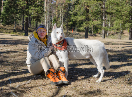 woman with a white dog in