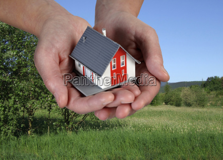hand with house before plot