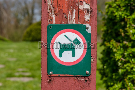 sign with a dog in a