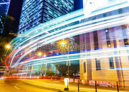 car light trails and urban landscape