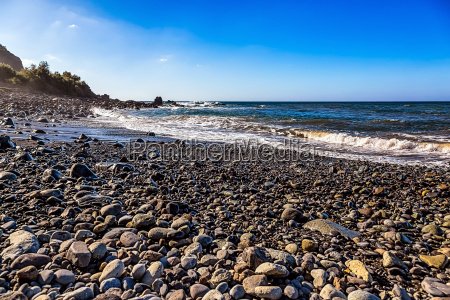 wild stone beach on coast