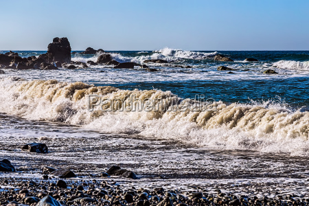 waves and foam on wild stone