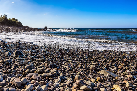 wild stone beach on coast of