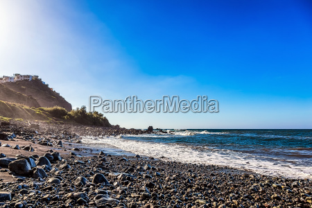wild stone beach on shore of