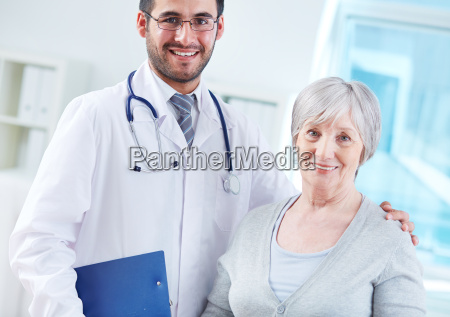elderly woman and her doctor