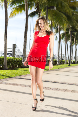 young caucasian woman walking outdoors marina