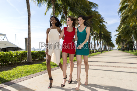 three women walking on a warm
