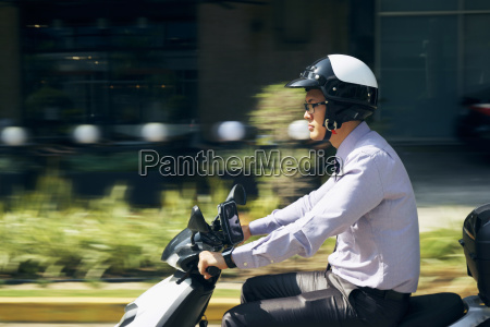 chinese businessman commuter riding scooter motorcycle