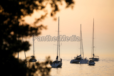 sailboats in adriatic sea at sunset