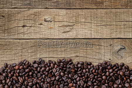 coffee beans on grain wood