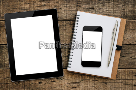 tablet and smartphone on wood background