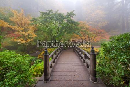 moon bridge in foggy fall morning