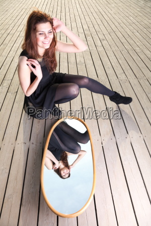 smiling woman with her reflection in