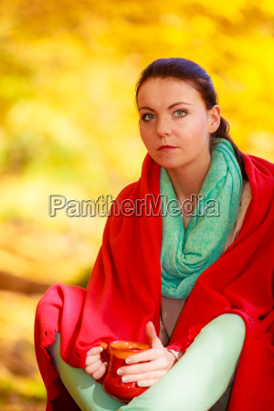 thoughtful girl in the autumn park