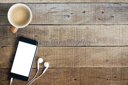 phone and coffee on wood blank