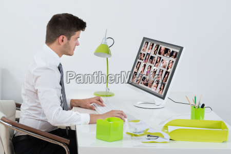 businessman editing images on computer