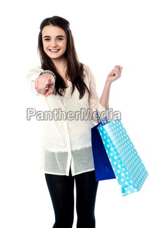 shopaholic teenager isolated on white