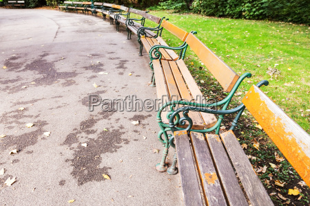 empty wooden benches in city park