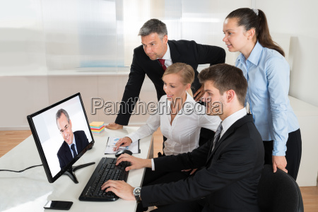 businesspeople videoconferencing on computer