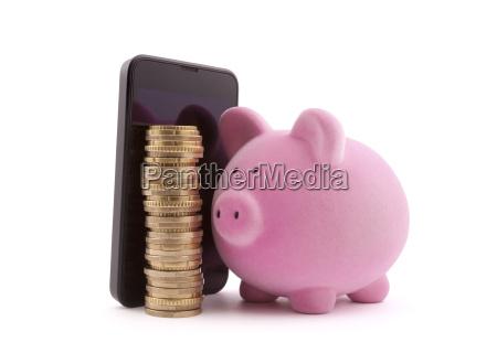hucha con telefono movil y monedas