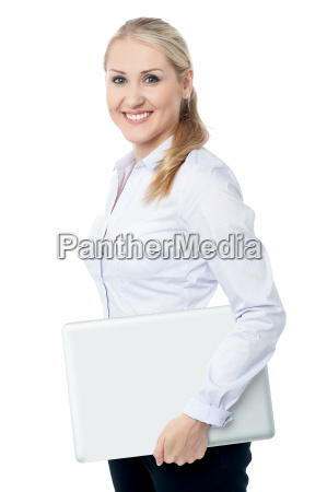 smiling young corporate woman with laptop