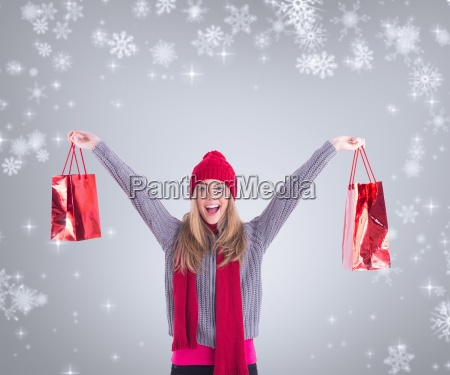 composite image of festive blonde holding