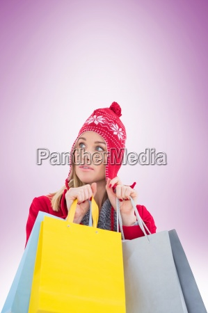 blonde in winter clothes holding shopping