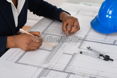 businesswoman drawing blueprint