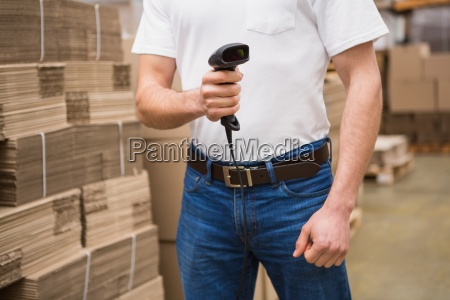 close up of warehouse worker holding