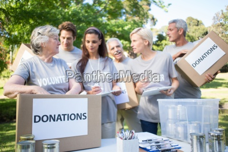 happy volunteer family holding donation boxes