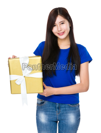 asian woman holding a big present
