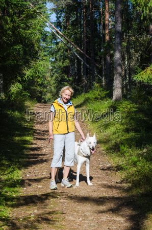 woman with a dog on a