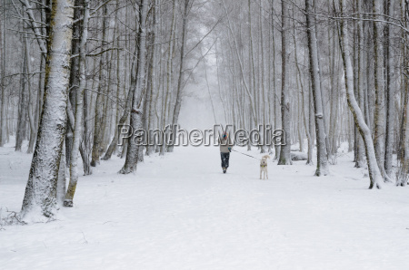 woman with dog on a snowy