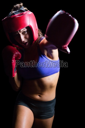 female boxer with gloves and headgear