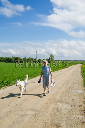 woman with a dog goes on