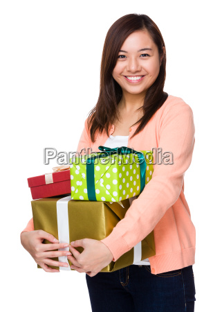 asian woman holding a lot of