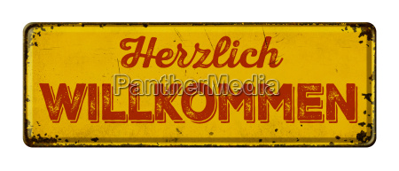old rusted tin sign welcome