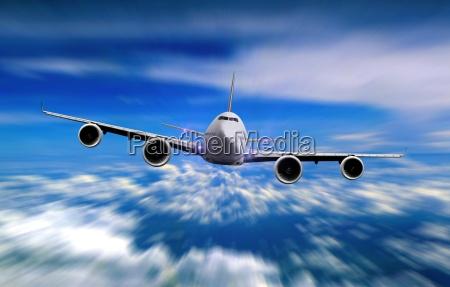 avion volando sobre cielo nublado