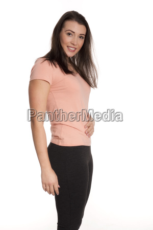 young woman in sports clothes touches