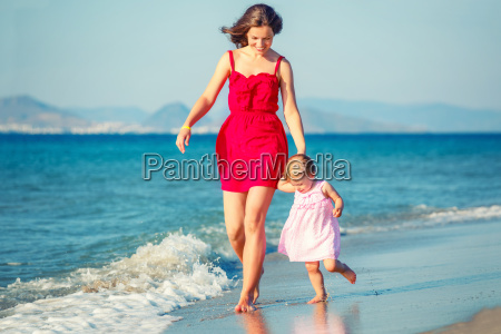 mother and daughter walking on the